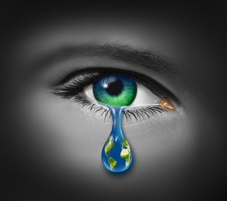 War and violence with the tear of a child and a planet earth in the reflection of the tear drop as a symbol of pain and world conflict on victims of crime or sadness on the state of the natural environment and polution. photo