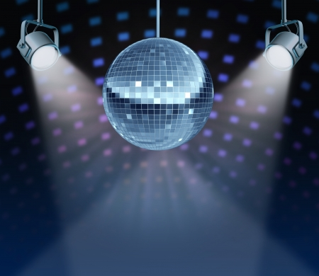 Dance night disco ball as a mirror ball symbol of fun and dancing party in a nightclub or dance club with glowing stage lights and wall reflexions