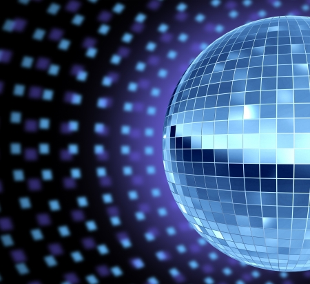 Dance party DJ culture with a disco mirror ball reflective sphere lights glowing for music dancing entertainment and cool groovy parties that make you move to the beat rythm of the techno song  Archivio Fotografico