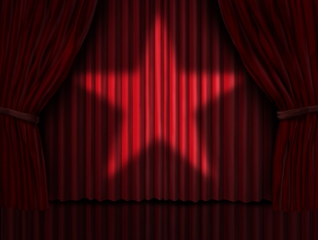 shinning: Red curtains with a star light shinning on the velvet drapes on a stage