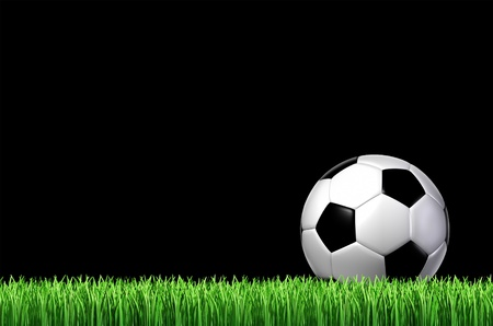 soccer ball on grass:  football team sport concept with a leather ball sitting on grass ready for a kick on a black night sky as a sporting icon of fun and physical play with sporting equipment  Stock Photo