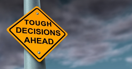 dilema: Difficult and tough decisions business journey symbol of uncertainty in a challenging financial situation and preparing for difficult solutions to problems as a yellow traffic sign on a stormy cloud background  Stock Photo