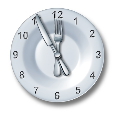 deadline: Lunch time dining concept with a fork and knife on a plate  Stock Photo