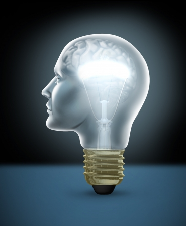 Human creativity concept with a glowing light bulb in the shape of a head with a brain showing inside the glass as a symbol of goal setting and business success by innovation and new ideas as solutions and answers to questions