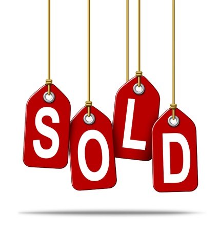 Sale and selling retail price tag sign with the text sold as a red label with hanging strings tied to the paper commercial symbols of merchandise or services that have been purchased from a store on white  Stock Photo - 13163410