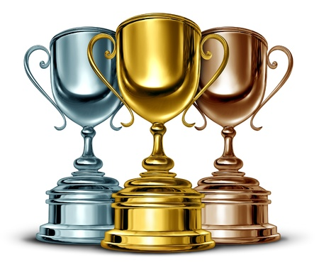 sportsmanship: Gold silver and bronze trophies and trophy award as the best three winners of a sport or sporting competition as a symbol of sportsmanship and success as a group of leaders in an important event on white