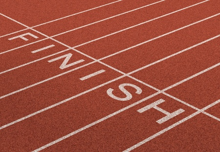 Finish Line as a business symbol of success in completing a planned strategy to acheive victory and reach the goals of financial freedom and wealth as a track and field background in dimensional perspective  photo