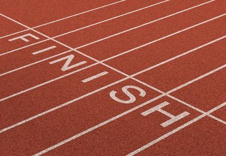 Finish Line como un símbolo de negocios de éxito en la realización de una estrategia planificada a acheive la victoria y alcanzar las metas de libertad financiera y la riqueza como una pista y campo en el fondo de la perspectiva unidimensional Foto de archivo