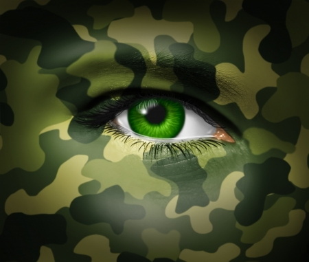 Military camouflage on a human face with a close up of the green eye gazing and looking representing war tactics and battle strategy in an army or business situation