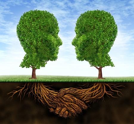 Colaboración en los Negocios el trabajo en equipo y el crecimiento de raíces en la forma de un apretón de manos y de los árboles, como las cabezas humanas de confianza e integridad en una relación cada vez mayor para el éxito de la riqueza financiera fuerte