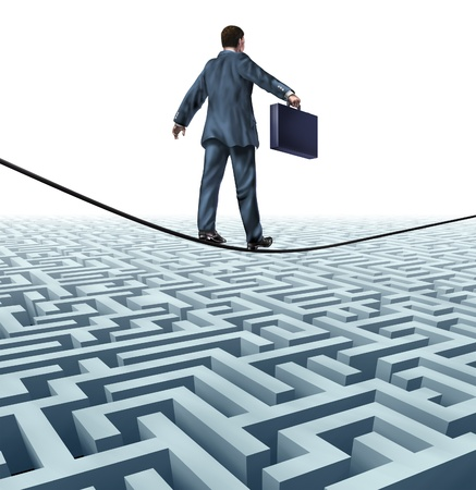 business challenge: Conquering adversity and rising above a challenge as a businessman with a briefcase on a tightrope walking above a complex maze obstacle as an innovative risk solution to find financial success  Stock Photo