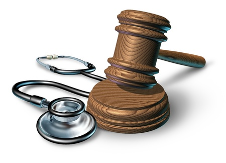 legal law: Medical malpractice and the legal proceedings in a work injury concept with a stethoscope and a judge gavel or mallet as a symbol of financial insurance law  issues in health care and medicine on white