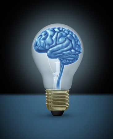 Idea with a human brain as a light bulb of  innovation as a  brilliant bright light  Foto de archivo