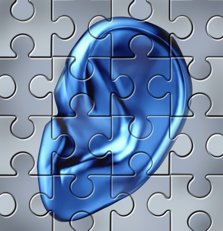 Human ear symbol on a jigsaw puzzle representing a medical listening condition that results in a deafness