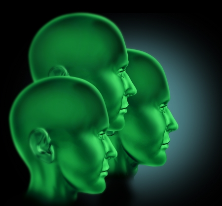 Teamwork and cooperation symbol represented by three green heads looking forward to success   photo