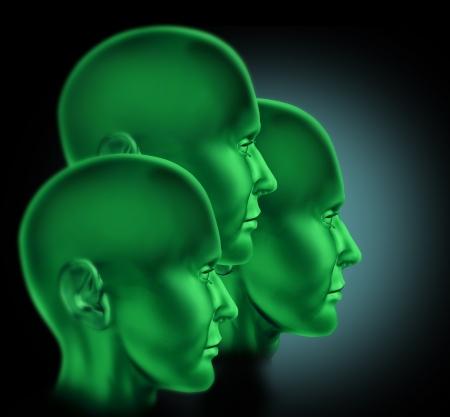 pensamiento estrategico: Trabajo en equipo y cooperación símbolo representado por tres cabezas verdes con ganas de éxito Foto de archivo