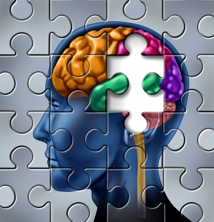 cognitive: Intelligence and memory loss symbol represented by a multicolored human brain with a missing piece of a jigsaw puzzle