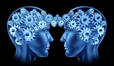 Teamwork and business cooperation with two human heads facing each other with gears and cogs representing their brains as a symbol of industry working together  Stock Photo