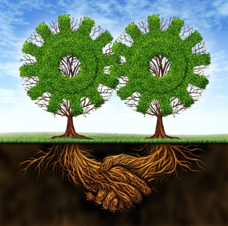 getting together: Business agreement and cooperation resulting in financial growth between two partners working together with the concept of two gear shaped trees with roots in the form of a hand shake  Stock Photo