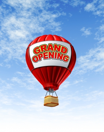 advertise: Hot Air Balloon grand opening announcement and advertisement with a blue summer sky background as a symbol of new business start  Stock Photo