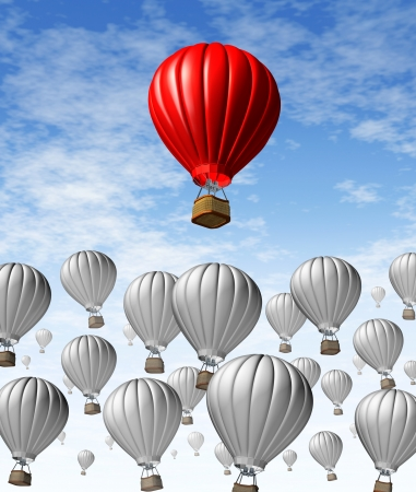 financial symbol: Rising to the top as a business and financial symbol of success with a group of grey hot air balloons and a red balloon standing out from the rest as the best with the most potentioal for growth  Stock Photo