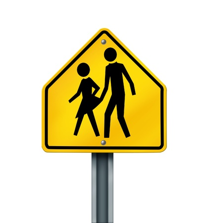 Sex abuse in school with a warning sign of a sexual predator abusing and attacking young innocent student victims represented by a yellow hazard sign with the criminal act isolated on a white background  photo