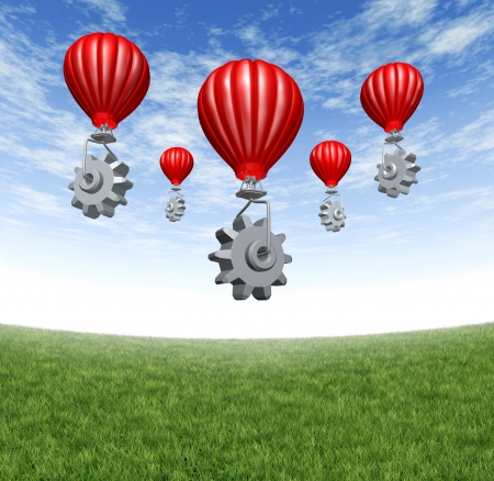 Internet cloud network with red hot air balloons lifting gears and cogs up to the sky as a mobility technology concept of virtual data and assembling a mobile industry partnership on a summer sky with grass  스톡 콘텐츠