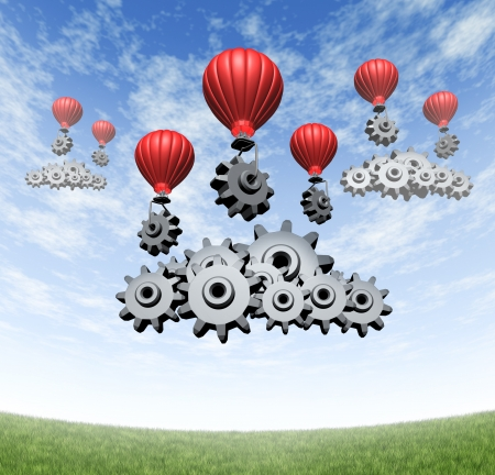 Wireless technology business concept and building an internet mobile cloud computing network with red hot air balloons with gears and cogs creating data server clouds on a blue summer sky and green grass  photo