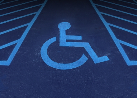 disabled parking sign: Handicapped and disabled symbol as a parking space with a wheelchair painted on asphalt as a health care and medical icon of reserved space for accessibility of the physically challenged  Stock Photo