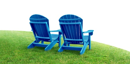 adirondack chair: Retirement Planning symbol with two empty blue adirondack lawn chairs sitting on green grass as a financial concept of future successful investment strategy on a white background  Stock Photo