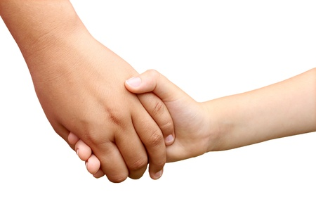 Children holding hands as a symbol of a brother and sister helping each other as siblings or school children in a grasp of unity isolated on white   photo