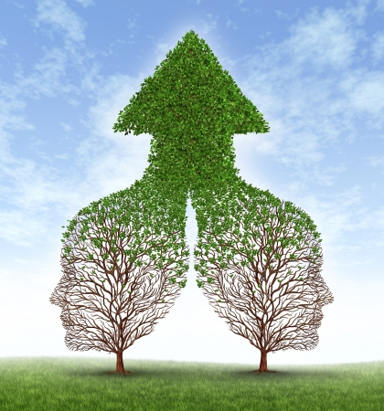 Growing together partnership with two trees in the shape of human business men heads merging as one to form a successful team resulting in fertile growth ass a leaf arrow pointing up  Stock Photo - 14837711