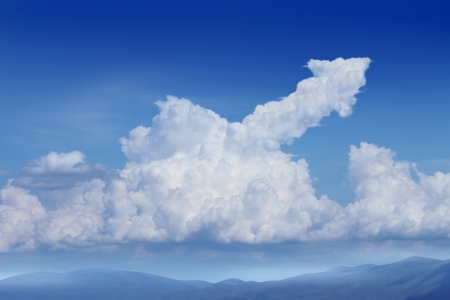 Success Dreams with a blue sky background and a cumulus cloud in the shape of an upward arrow as a financial concept for planning and dreaming about future strategy  photo