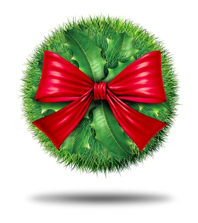Christmas sphere decoration and winter holiday decorative design ornament for the celebration of  the season with a ball of holly and pine needles with a big red festive bow Stock Photo - 15206259