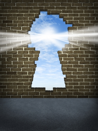 free your mind: Break through and the solution or answer to success as a breaking down walls concept for business or a free your mind icon for personal concepts with an old urban brick wall with a damaged hole in the shape of a key hole
