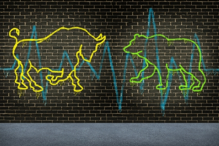 investing: Street trading market advice financial investing symbol with a graffiti texture of a bull and a bear painted on an urban street brick wall as an investment concept for selling or buying a company