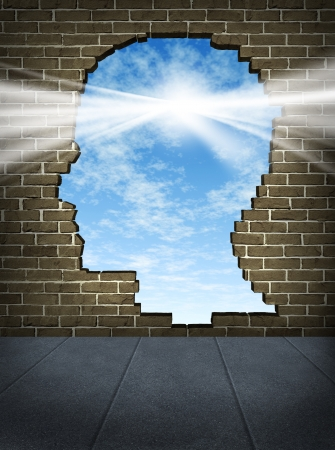 breaking free: Power of the mind and free your brain mental health symbol of spirituality and freedom of thought with a human head shaped hole on a brick wall in an urban city street with a glowing sun on a blue sky