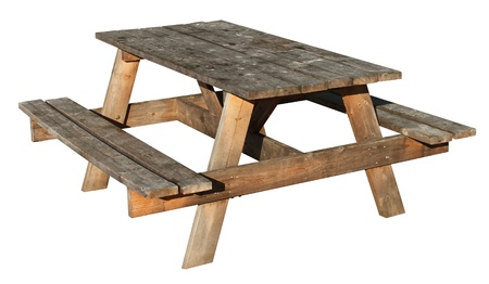 table: Picnic Table made of weathered wood on an isolated white background as a symbol of summer and barbecue leisure activity