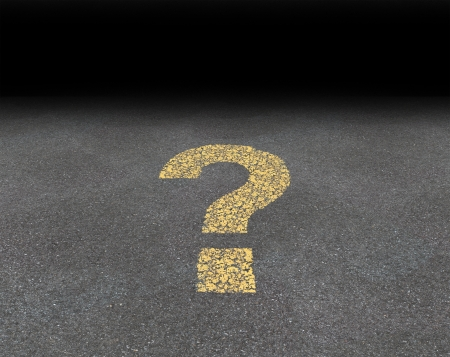 road mark: Question mark painted on an asphalt road as a symbol of strategy and decisions concept finding answers and solutions to confusing questions