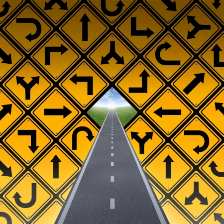 challenges: Success plan and breaking through the confusion with a wall made of a group of yellow street direction signs in a confused arrangement and a straighe road or highway going to a clear blue sky finding the solution  Stock Photo