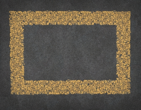 Yellow Line Road blank rectangular Frame on black asphalt as a transportation and highway traveling design element  photo
