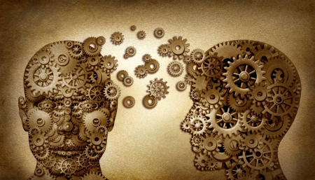 brain function: Education and leadership teamwork and lead and learning symbol by two human heads frontal and side view shaped with gears on a grunge old vintage document as an idea made of cogs working together in a team partnership
