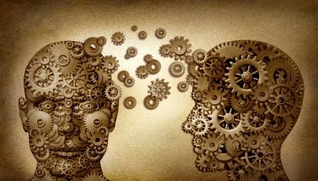 psicologia: La educación y el trabajo en equipo y liderazgo plomo y el aprendizaje símbolo por dos cabezas humanas vista frontal y lateral con engranajes en forma de un documento grunge viejo vintage, una idea hecha de engranajes trabajando juntos en una asociación de equipo Foto de archivo