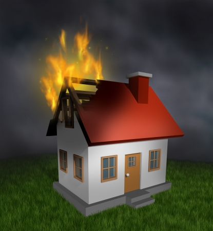 fire damage: House fire and burning home insurance symbol with a burnt damaged residential structure that shows the destruction in flames  and the importance of  smoke alarm and security systems  Stock Photo