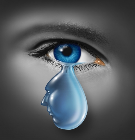 Grieving and human grief concept with a human face and eye crying due to a painful loss or relationship break up with a tear in the shape of a head as a symbol of mental health problems