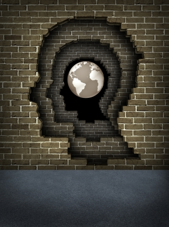 Breaking through obstacles to success with broken brick walls in the shape of a human head leading to the globe of the earth as a business and life concept of achievement and career goals and focus on aspirations  photo