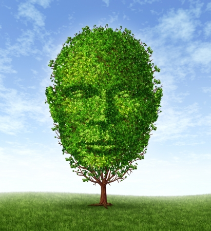front facing: Personal development and personality growth as a medical symbol of psychology as a tree in the shape of a front facing human head as intelligence and social thinking for mental behavior health  Stock Photo