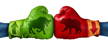 Stock market trading business concept with two boxing gloves with arrows going up and down with bull and bear icon emblems stitched to the glove as investment decisions and financial success