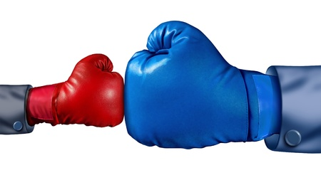 adversity: Competition and adversity and fighting the establishment as a new small business against a huge established corporation as a smaller boxing glove versus a huge one as a symbol of overcoming challenges with courage and conviction  Stock Photo