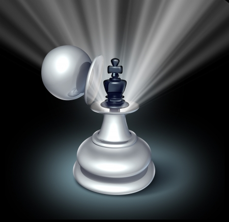 power within: a chess game king figurine revealed inside a large pawn disguise Stock Photo